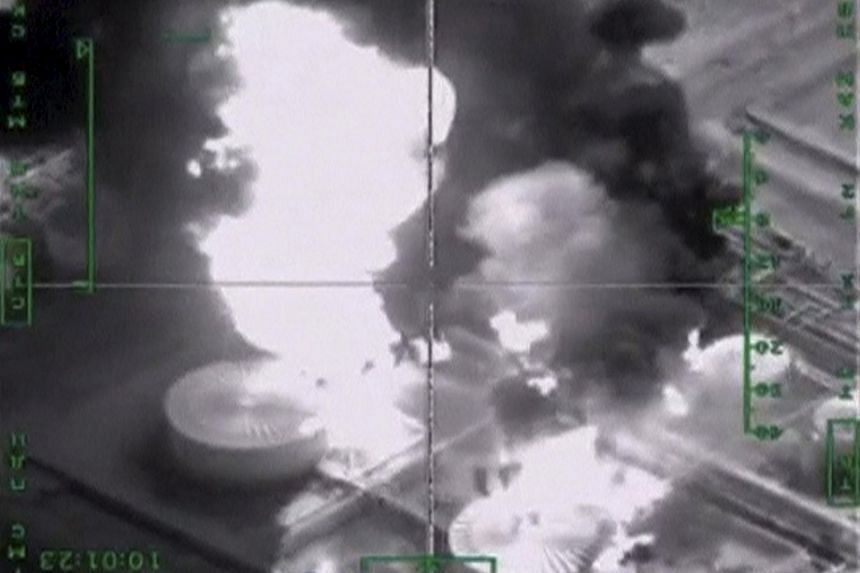 Oil infrastructure, which Russia's Defence Ministry says is controlled by ISIS militants, is seen hit by Russian air strikes in this still image from a video released on Nov 18.