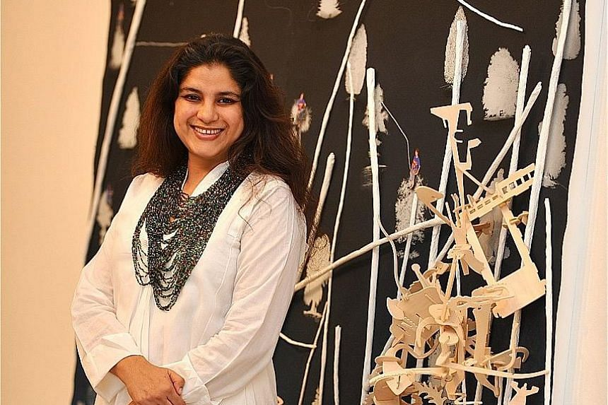 The late Hema Upadhyay, at her solo show, Universe Revolves On at the STPI in 2008.