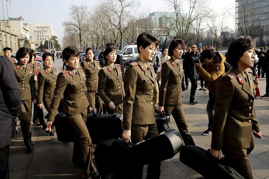 Moranbong Band (right), led by Ms Hyon Song Wol (above), left Beijing on Saturday, when it was to perform at the first of three shows.