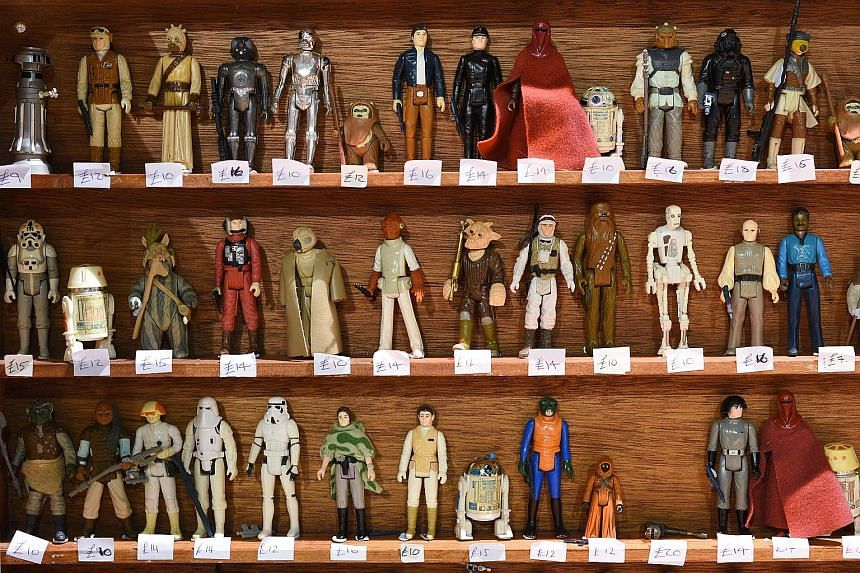 (Clockwise from far left) Star Wars action figures on sale in Manchester, United Kingdom, pet leashes at a Los Angeles store and neckties at a stall in an unofficial Star Wars convention held earlier this month in northern England. Sales of merchandi