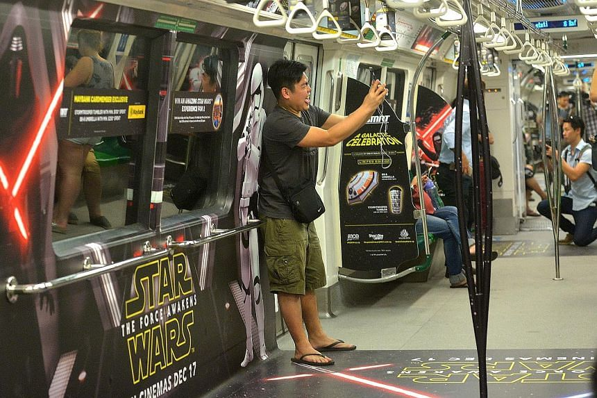 They may not travel at light speed, but commuters can now ride to an MRT station far, far away as Star Wars fever comes to Singapore's trains. From now until Dec 31, carriages on two SMRT trains on the North-South and East-West lines will feature mov