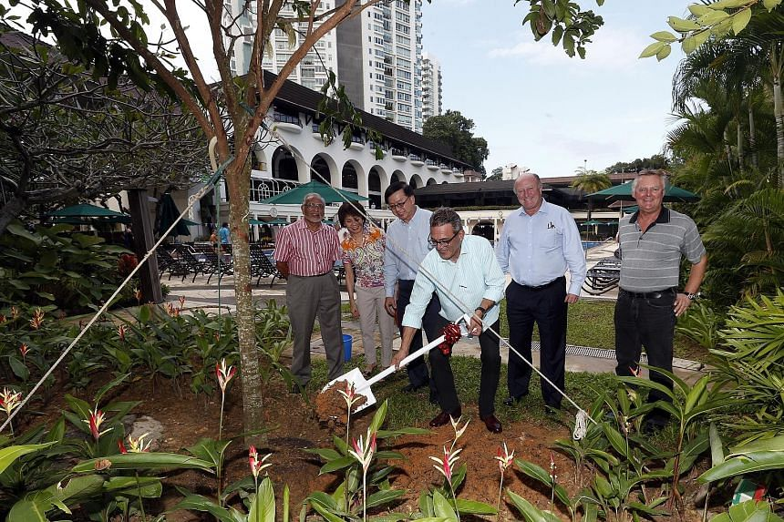 Tanglin Club president Robert Wiener planting a tree on Monday to mark the club's 150th anniversary, watched by (from left) Mr Zoeb Sadiq, the sports and recreation convenor, committee member Ho Chee Lin, vice-president Eugene Lim, honorary treasurer