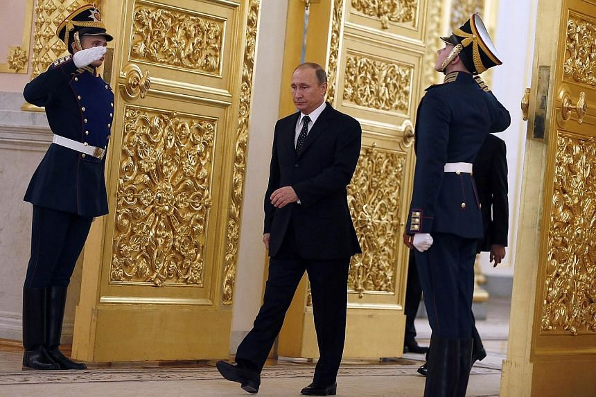 Video footage shows that when Mr Putin walks, his left arm swings normally but his right arm barely moves.