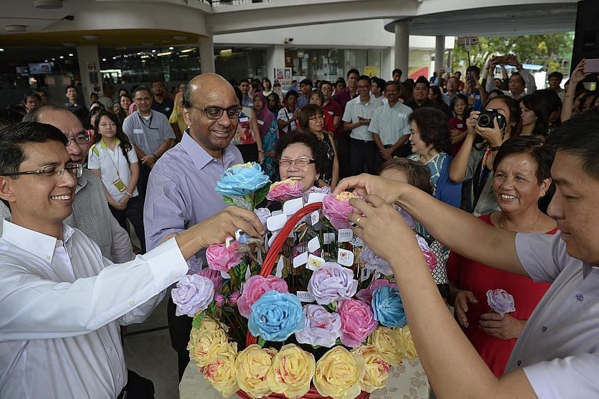 Deputy PM Tharman Shanmugaratnam at yesterday's opening of the Taman Jurong SSO, with Minister of Social and Family Development Tan Chuan-Jin (far right) and Parliamentary Secretary at the Ministry of Education and Ministry of Social and Family Devel
