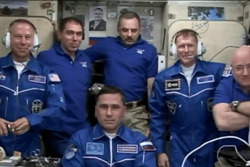 The current crew and the new arrivals speaking to family members from the ISS.