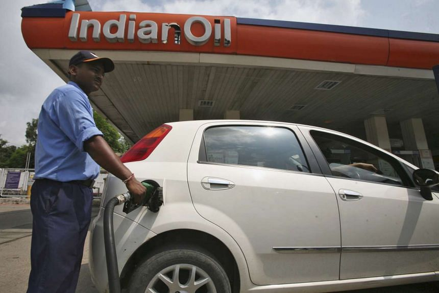A worker filling a car with diesel at a petrol station in Jammu in 2013.