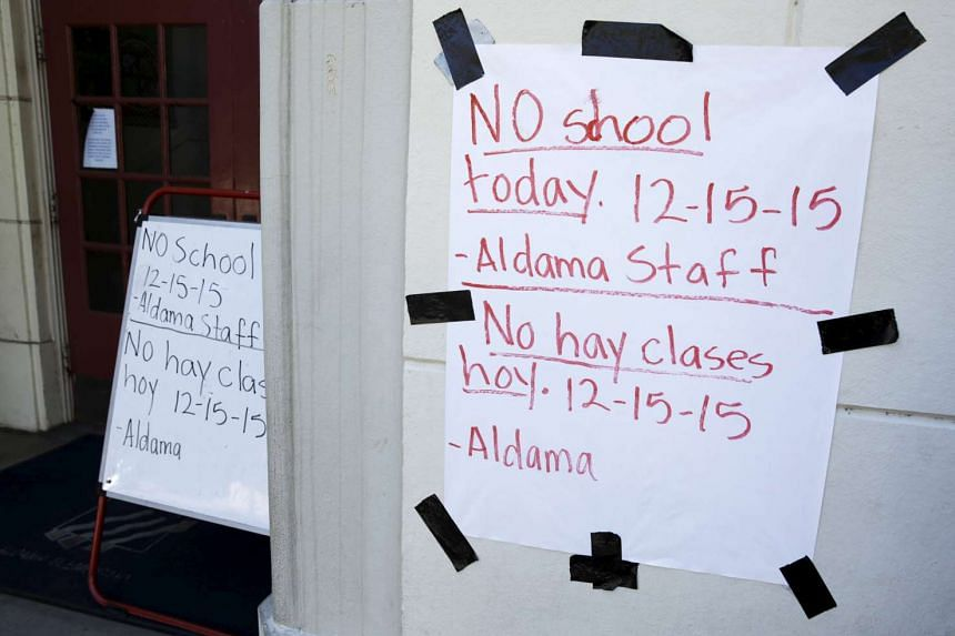 A sign announcing no school is pictured at Aldama Elementary School in the Highland Park neighborhood of Los Angeles, California Dec 15, 2015.