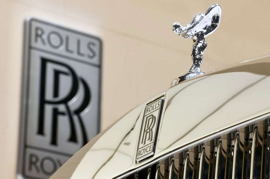 British car and engine manufacturer Rolls-Royce is to axe senior staff and restructure its operations after a series of profit warnings.