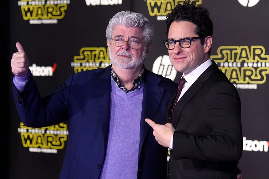 J.J. Abrams (right), writer-director of Star Wars: The Force Awakens, with George Lucas (left), creator of the Star Wars and Indiana Jones franchises, at the Hollywood premiere on Monday.