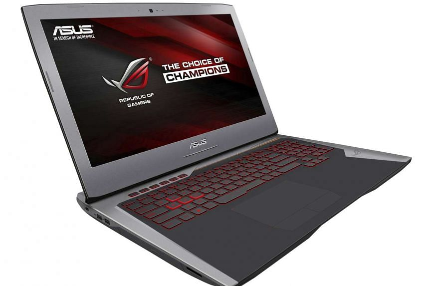 Asus' G752 bucks the trend of black gaming laptops with its brushed aluminium finish and orange highlights.