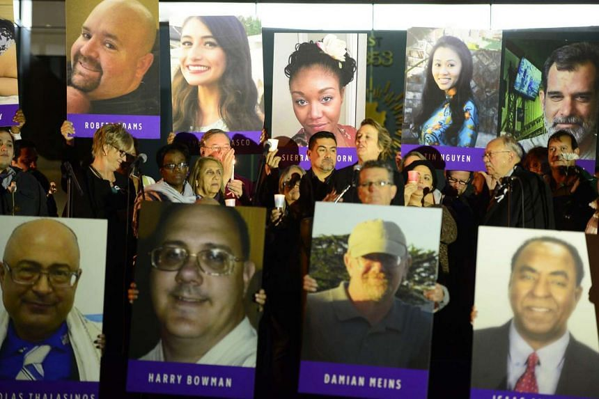 Pictures of Malik's victims displayed during a candlelight vigil.