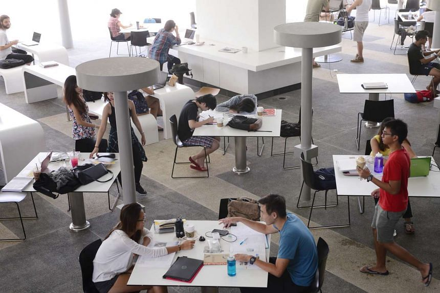 Students study at a common area at NUS U-Town.