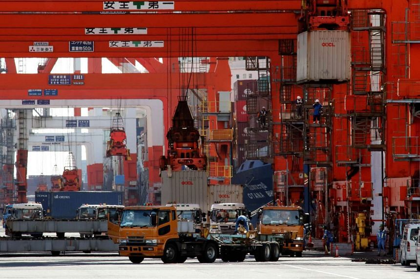 Containers being loaded at Tokyo's port on Nov 19, 2015.