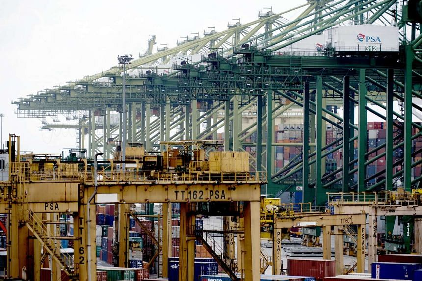 Stacked containers sit among gantry cranes at Tanjong Pagar Container Terminal.