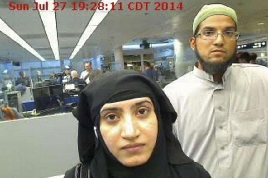 Tashfeen Malik, (left), and Syed Farook are pictured passing through Chicago's O'Hare International Airport in this July 27, 2014 handout file photograph.