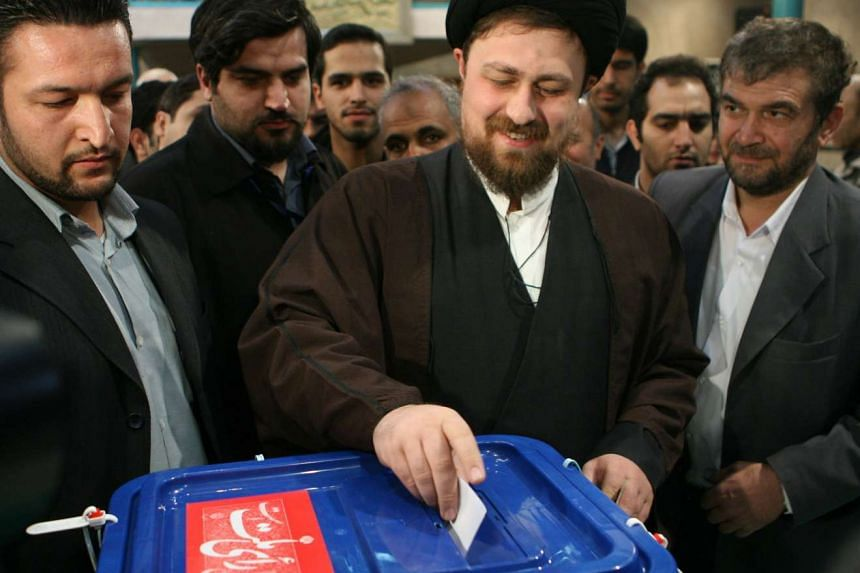 Hassan Khomeini (centre), grandson of Iran's late Ayatollah Ruhollah Khomeini, casting his ballot at a polling station in 2008.