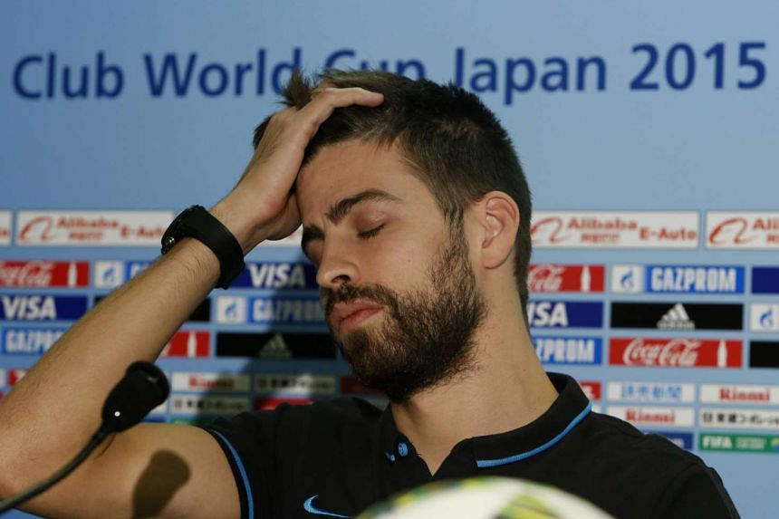 Gerard Pique attends a news conference ahead of his team's Club World Cup semi-final football match against China's Guangzhou Evergrande in Yokohama.