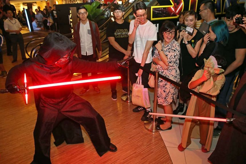 A young guest (right) dressed up as a Yoda, a Star Wars character, at the gala premiere of Star Wars: The Force Awakens on Dec 16, 2015.