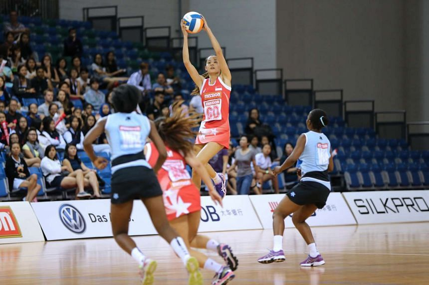 Team captain Micky Lin catches a pass as Singapore fell to Botswana 38-46 in yesteday's Mission Foods Nations Cup.