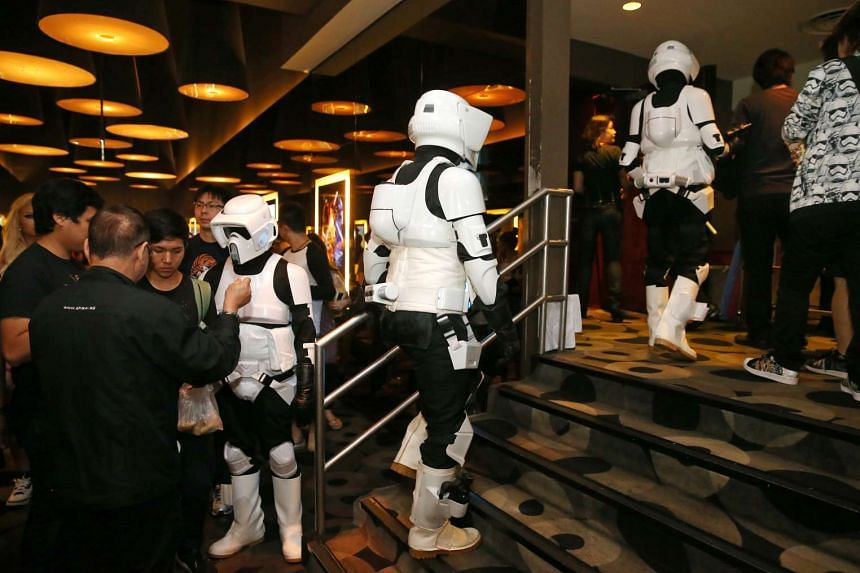 Fans dressed up as stormtroopers at the gala premiere of Star Wars: The Force Awakens on Dec 16, 2015.