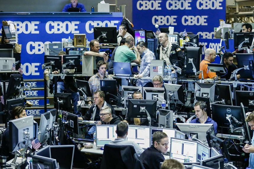 Traders at the Chicago Board of Options Exchange in Illinois, USA on Dec 16, 2015.