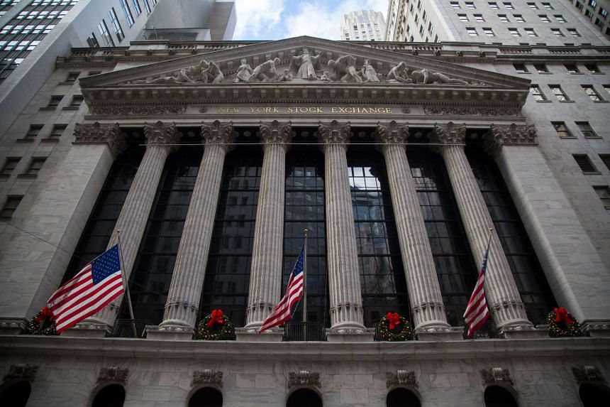 American flags wave on the exterior of the New York Stock Exchange (NYSE) in New York.