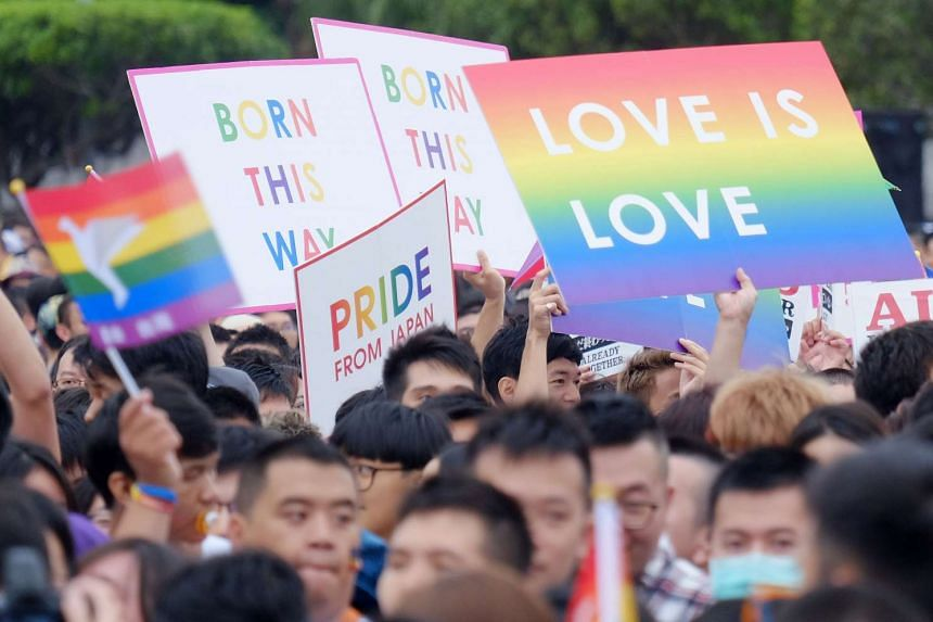 Local residents taking part in the annual gay rights parade in Taipei on Oct 31, 2015.