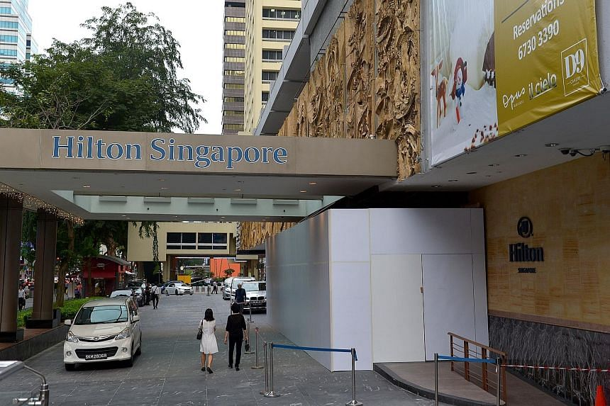 A false ceiling at Hilton hotel's driveway caved in on Sunday, resulting in four people being taken to hospital. Visitors now have to enter the hotel via its shopping gallery entrance.