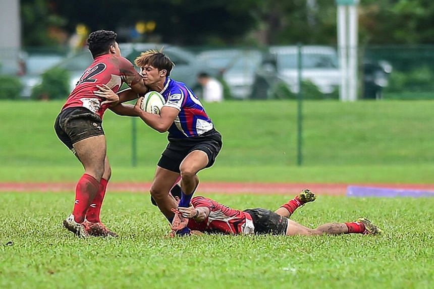Ahmad Zuhri Idris of Singapore (left) stopping a Chinese Taipei attacker as the Republic lost 16-21 on the second day of the Asian Rugby Under-19 Championship. The hosts saw some chances in the last 10 minutes wasted as they suffered their second def