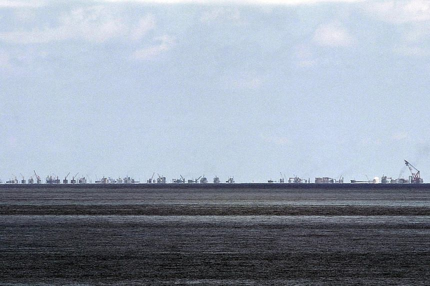 Alleged ongoing land reclamation by China at Subi Reef in the Spratlys group of islands in the South China Sea is captured in this photo taken in May this year. The uncompromising stance of Beijing on territorial disputes, such as the one over the Sp