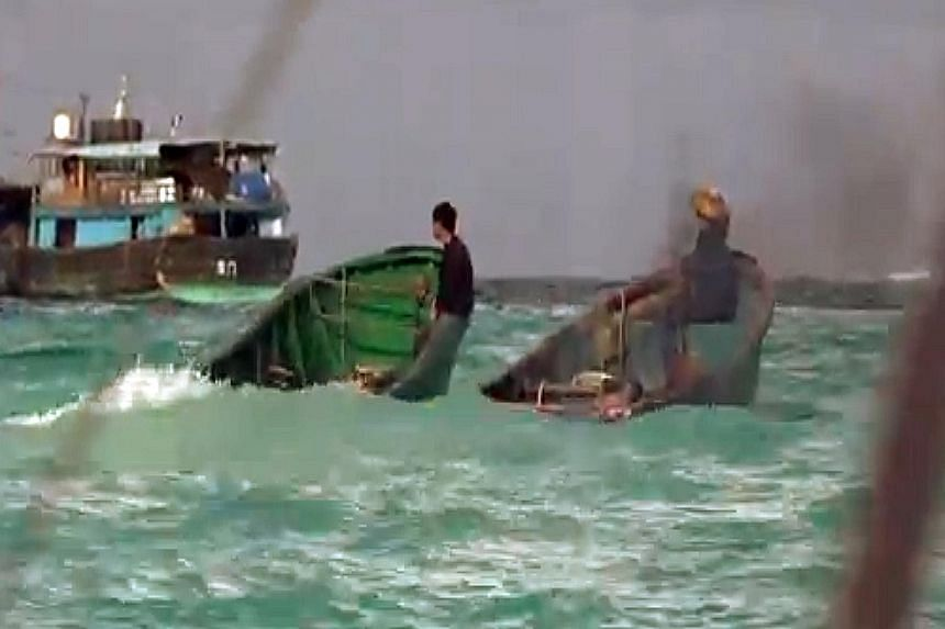 Chinese fishermen (above) are destroying large areas of reefs (below) near a group of Philippine-controlled atolls in the Spratly Islands, the BBC has reported. The Philippines, Brunei, Vietnam, Malaysia and Taiwan all have overlapping claims in the