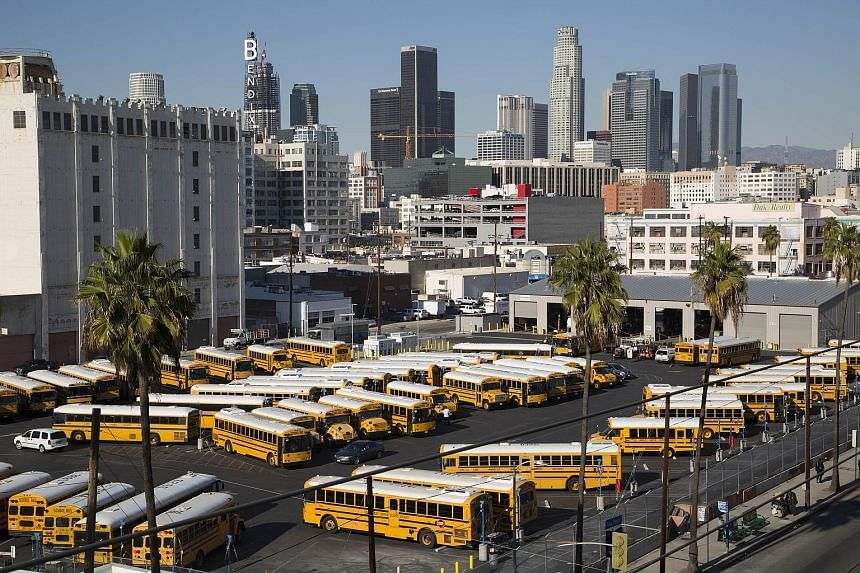 School buses standing idle as all Los Angeles city schools were shut down on Tuesday, in reaction to an e-mailed terror threat. The warning was later deemed a hoax, and schools reopened yesterday.