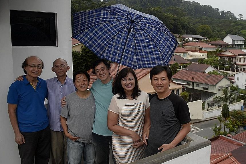 There is a strong sense of camaraderie among the residents of Fuyong estate, including (from far left): Mr Chia Yee Kim, 70; Mr Steven Chua, 58; Madam Chua Chan Hee, 55; her husband Oh Chai Hoo, 55; Mrs Dave Ng, 54; and Mr Wong Yuen Lik, 44.