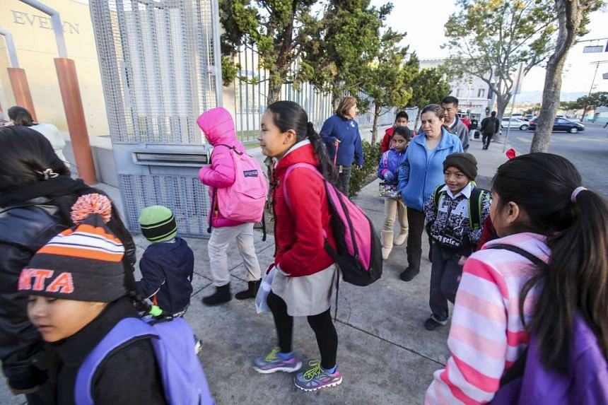 Students arrive at a school in Los Angeles on Dec 16, 2015.