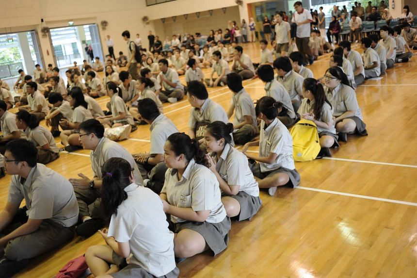 Students at Bedok Green Secondary School waiting to get the results for their N-level examinations on Dec 17, 2012.