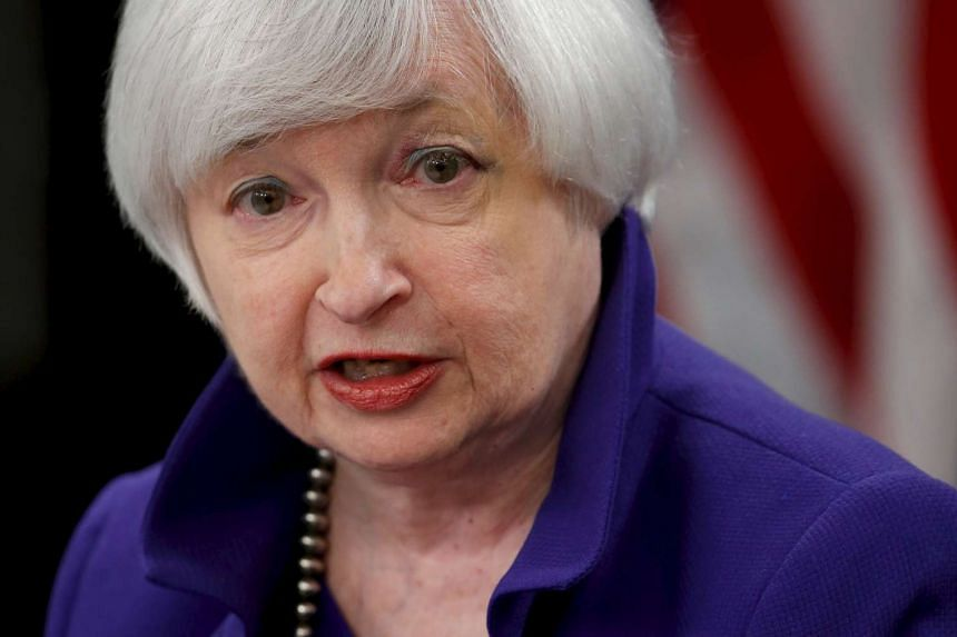US Federal Reserve chairman Janet Yellen answers a reporter's question.