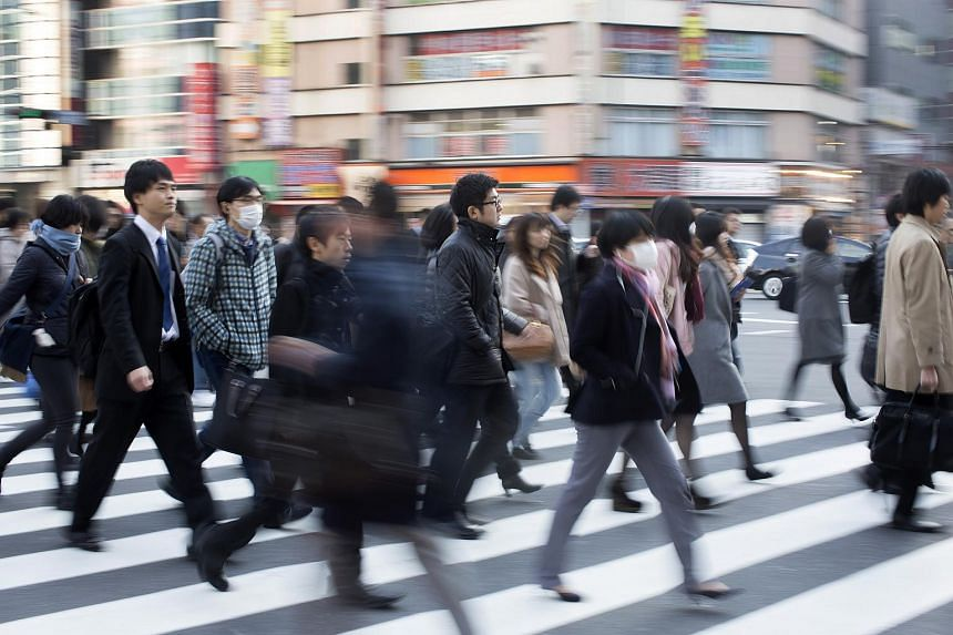 Commuters in Tokyo on Dec 10.