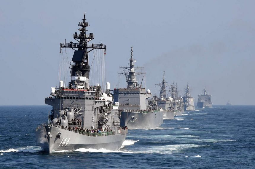 Japanese Maritime Self-Defence Force ship Kurama (left) sailing with other vessels off Sagami Bay, Kanagawa prefecture, on Oct 18.