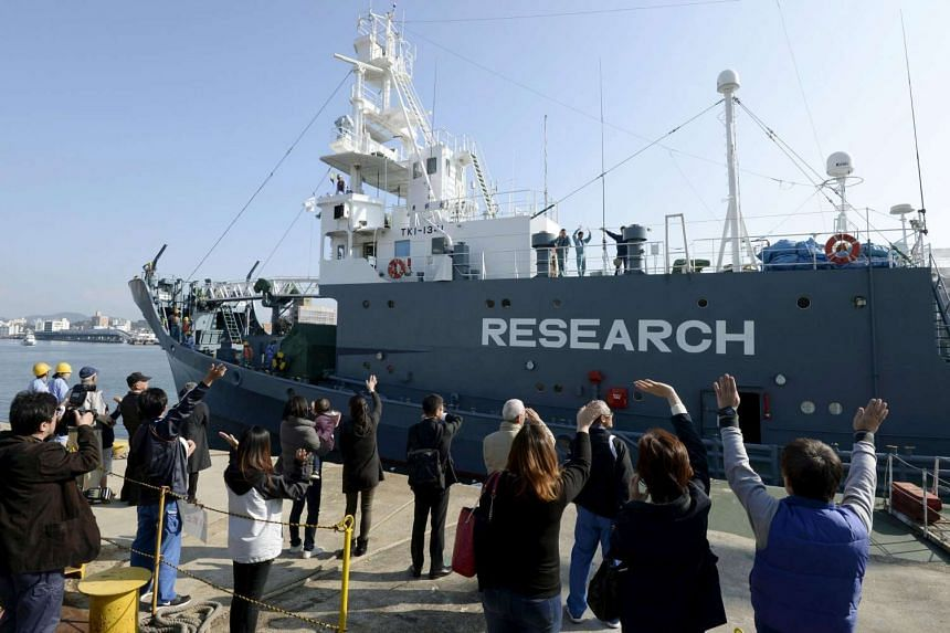 Families of crew members waving as Japanese whaling vessel Yushin Maru leaves for the Antarctic Ocean at a port in Shimonoseki on Dec 1.