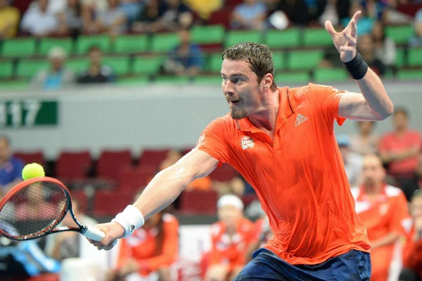 Marat Safin of the Japan Warriors hits a return against Carlos Moya of the Singapore Slammers during their men's singles match.