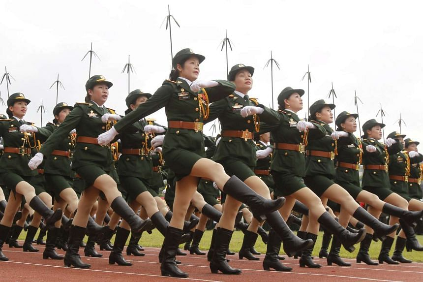Vietnamese soldiers from a communication unit march during the 60th anniversary celebrations of the Dien Bien Phu battle.