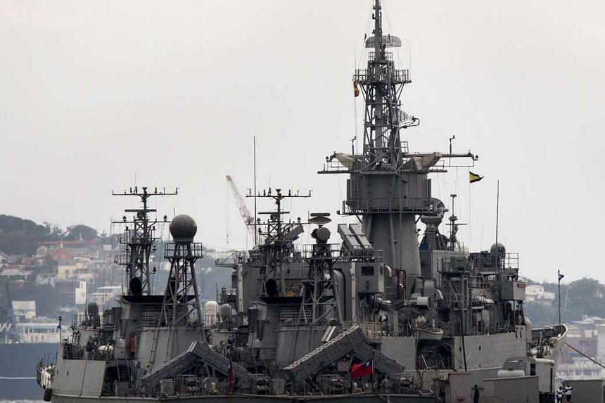Two Taiwanese Navy ships made in the US are seen docked at the naval base in Keelung harbour.