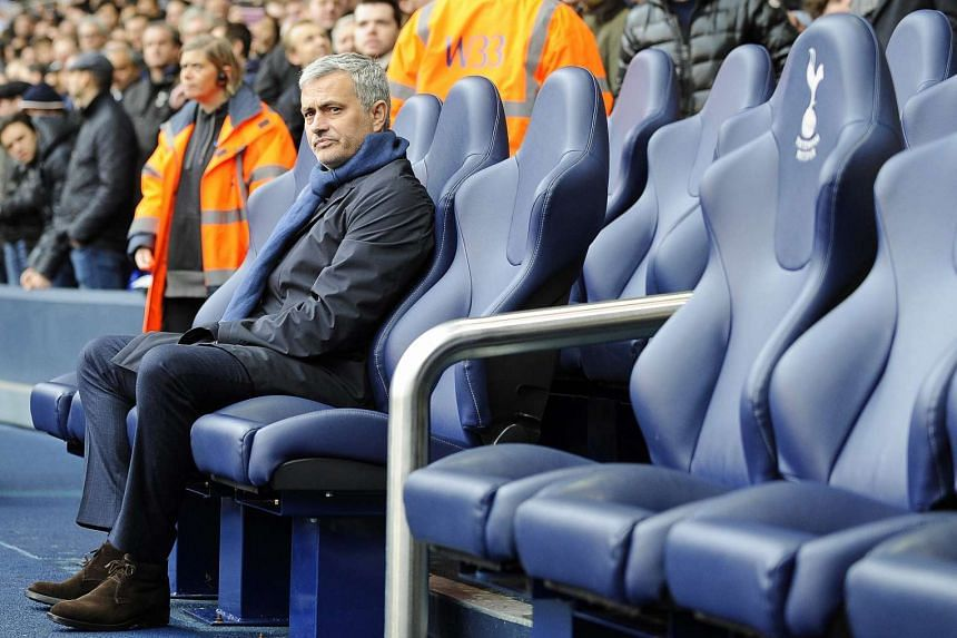 Chelsea manager Jose Mourinho taking his seat for a match against Tottenham Hotspur at White Hart Lane in London on Nov 29.