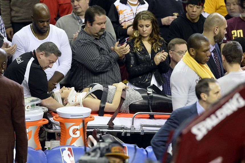 Ellie Day, wife of golfer Jason Day, leaves the arena on a stretcher after she was run into by LeBron James.