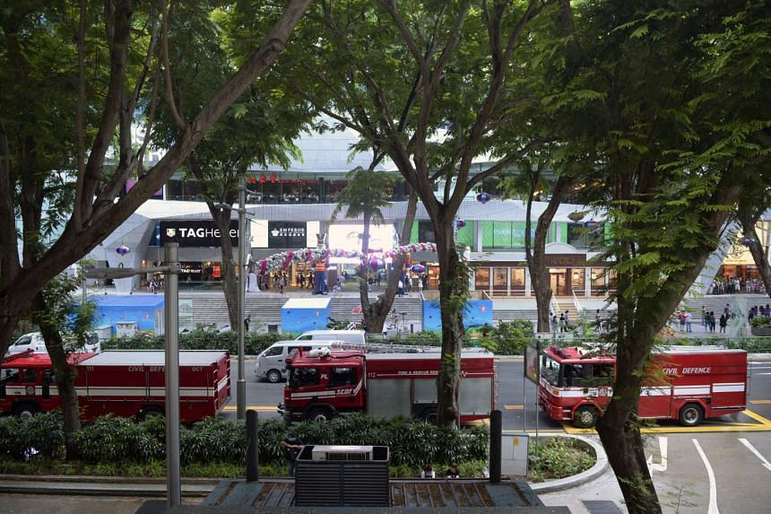 SCDF vehicles are seen outside Lucky Plaza on Orchard Road.