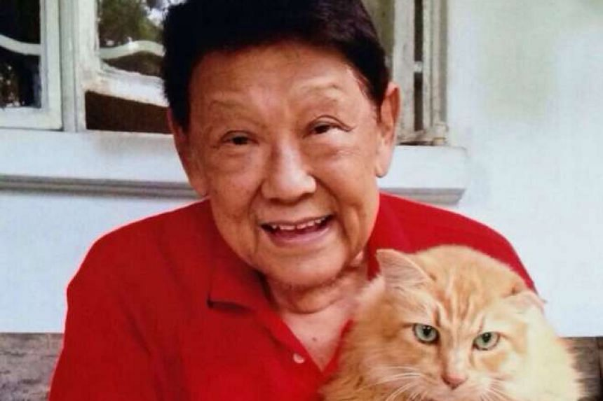 Radio and TV veteran Tan Swee Leong with his cat Ouzo.