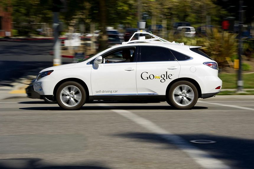 A man drives a Google self-driving car in front of the company's headquarters in California, US, on Sept 27, 2013.