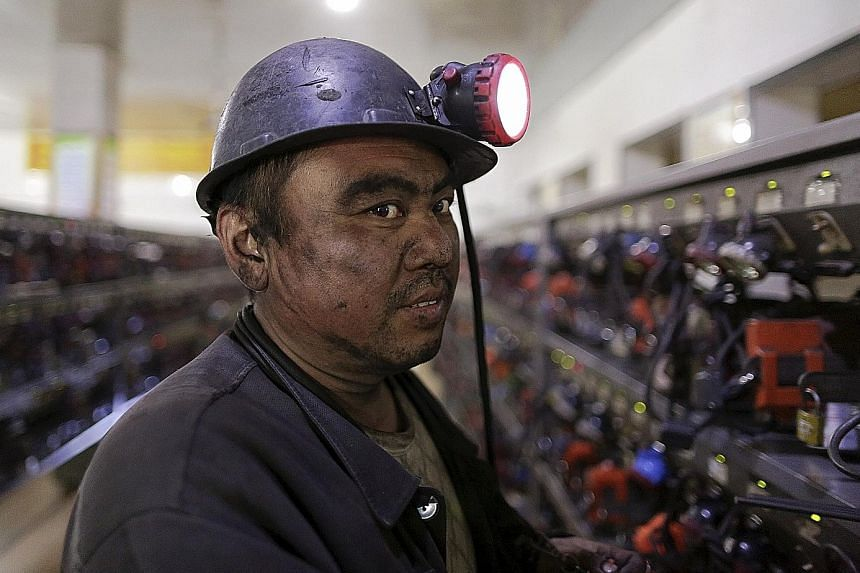 A worker at a Longmay mine in Heilongjiang. The Longmay Group is the biggest coal company in north-eastern China. It announced in September that it planned to lay off 100,000 workers.