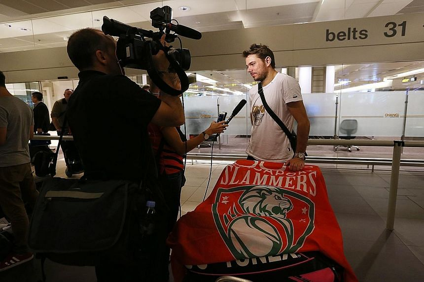 "Stan Wawrinka, the headline act for the Singapore Slammers, on arrival in Singapore yesterday. He hopes his clash with Roger Federer will be ""a good show for the crowds""."
