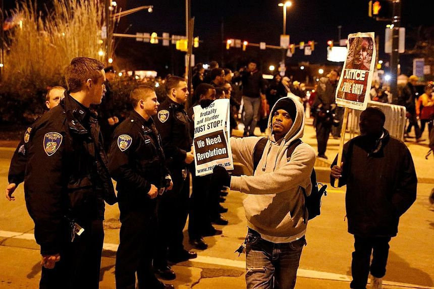 Protesters marching through the streets of Baltimore after a mistrial was declared in the trial of police officer William Porter. It was the first of six trials of police officers involved in the death of Freddie Gray.